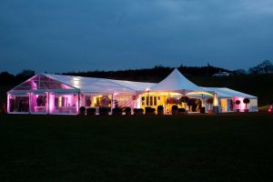 marquee at night in field