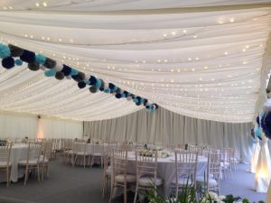 marquee with lights and table furniture