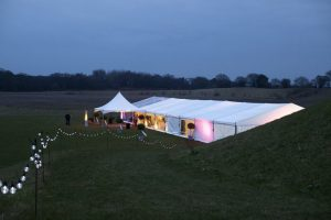 marquee with lights on at evening