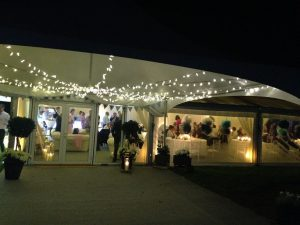 marquee with doors and tables at night