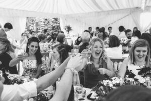 cheers to the happy couple in the marquee