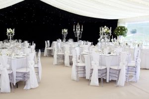 wedding marquee with tables chairs and candelabra