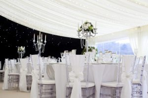 star backdrop marquee with white and crystal wedding furniture