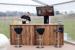 bar man in marquee