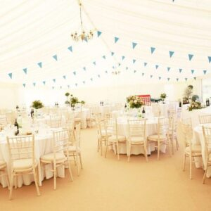 Marquee Bunting and Chaivari lime wash banqueting chairs