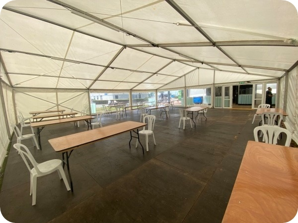 Social Distancing Marquee with tables and chairs